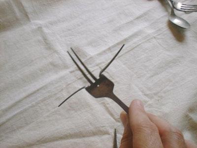 DIY your own silverware wind chimes! www.orsoshesays.com #diy #windchimes #silverwarewindchimes #homedecor #crafty