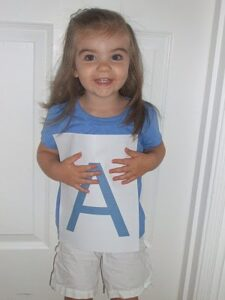 Learning the Alphabet with an ABC Photo Book (she: Rebecca)