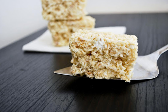 these coconut rice krispy treats are winners. The toasted coconut adds that awesome nutty flavor as well as pumps up the soft chewiness of these treats. Get the recipe on www.orsoshesays.com #recipe #dessert #treats #coconut #ricekrsipytreats #coconutricekrispytreats