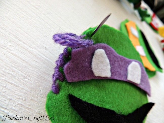 Felt Ornaments - Craft Your Kids' Favorite Characters this Christmas www.orsoshesays.com #christmas #DIY #feltornaments #ninjaturtles #hellokitty #characterornaments