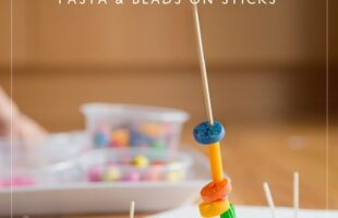 Set up an invitation to play using pasta an beads on sticks.