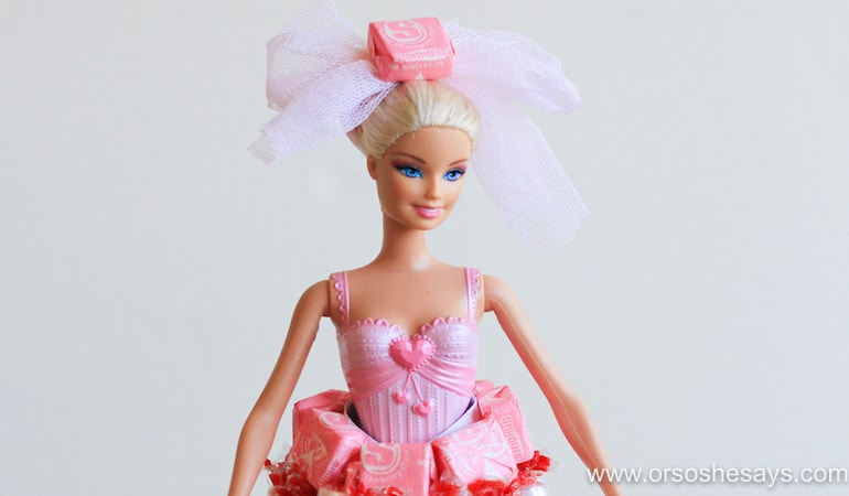 Put together this fantastic DIY candy doll using just a few craft supplies you're likely to have in your recycle bin. See the how-to on www.orsoshesays.com.