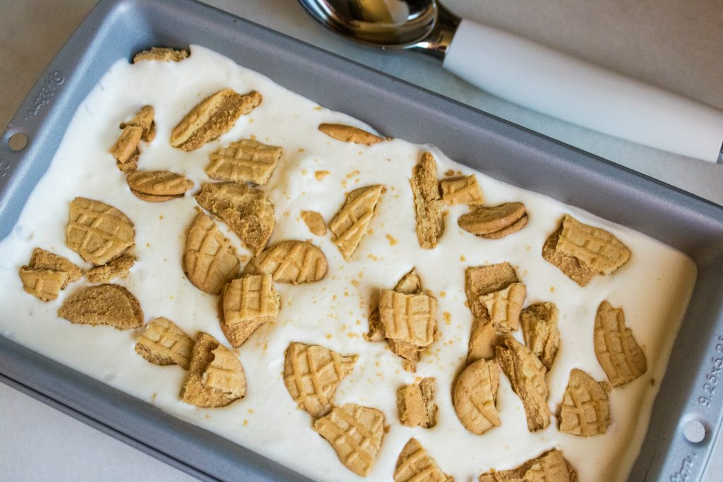 Nutter Butters add a great flavor to this no-churn ice cream. Enjoy one last summer hurrah with crumbled cookies layered between sheets of ice cream. #icecream #dessert #nutterbutters #cookies #summer #recipe #osss #orsoshesays #mormonblogger #mormon #ldsblogger #lds