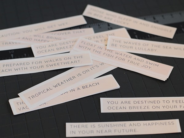 DIY fortune cookie messages are a lot easier than you may think! Get the tutorial on orsoshesays.com. #DIY #fortunecookies #DIYfortunecookiemessages #fortunecookiemessages #surprisevacation #vacationsurprise #OSSSdoesDisney #getawaytoday #disneyvacation